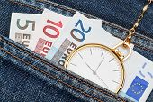 stock photo of watch  - Pocket watch with chain in jeans and money euro - JPG