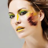 Beautiful woman with bright makeup. Close-up portrait.