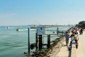 eople fishing on the beach promenade