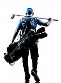 stock photo of golf bag  - one man golfer golfing golf bag walking  in silhouette studio isolated on white background - JPG