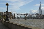 London Millennium bridge, view across Thames River towards the Shard