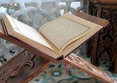 Quran and wood lectern
