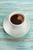 image of stimulating  - Cup of coffee on old wooden table - JPG
