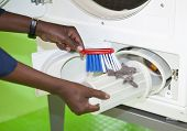 Close up of cleaning the laundromat