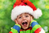 Christmas excitement - ecstatic young boy on christmas morning