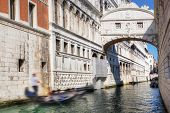 Venice, Italy. The Bridge of Sighs, gondola floats on a canal among old Venetian architecture