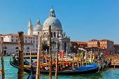 Venice, Italy. Basilica Santa Maria della Salute and Grand Canal. Old Venetian architecture, boats at sunny day