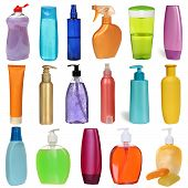 17 colored plastic bottles with liquid soap and shower gel isolated on white background .