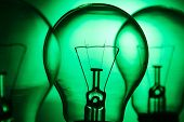 Row Of Light Bulbs On A Bright Green Background