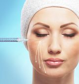 Beautiful face and the syringe (plastic surgery and botox injection concept)