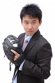 Young Business Man Pitching Baseball