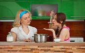 Two Girlfriends On The Kitchen