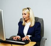 Beautiful blond help desk office support woman with headset