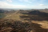 foto of ulaanbaatar  - The sweeping remote hills of Mongolia are marked only by primitive roads and clusters of simple cabins.