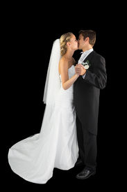 stock photo of waltzing  - Sweet young married couple dancing viennese waltz kissing each other - JPG