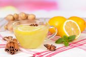 Healthy ginger tea with lemon and honey on table on light background