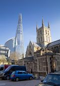 LONDON, UK - MARCH 29, 2014  Southwark Cathedral and Shadr of glass  South bank walk of the river Th
