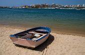An Old Fishing Boat On A Farragudo Beach, Algarve, Portugal