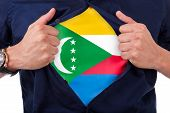 Young Sport Fan Opening His Shirt And Showing The Flag His Country Comoros, Comorian Flag