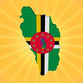 Dominica map flag on sunburst illustration