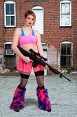 foto of rave  - Woman dressed to go to a rave dance party with gun - JPG