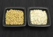 Oat And Flakes In Bowls Of Chinaware On Black Mat