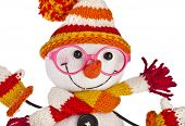 happy snowman spectacled in knitted hat and scarf close up isolated on white background