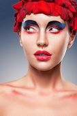closeup face portrait of woman over blue