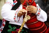 stock photo of bagpipes  - Color shot of a person holding a traditional Romanian bagpipe - JPG