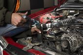 Auto repairman pouring antifreeze into radiator