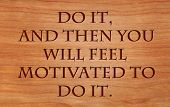 Do it, and then you will feel motivated to do it - motivational quote by Zig Ziglar on wooden red oa