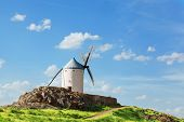 Ancient windmills in the sunny summer day Konsuegra Spain