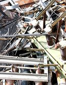 picture of scrap-iron  - piles of scrap iron with broken and rusted objects in a special waste landfill - JPG