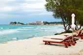 Sunbeds On A Beach And Turquoise Water At The Modern Luxury Hotel, Halkidiki, Greece