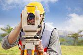 Surveyor Engineer Making Measure In Outdoor