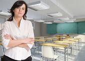 Portrait of a young female teacher in a classroom