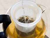 pic of boiling water  - making green tee in glass teapot with boiling water  - JPG