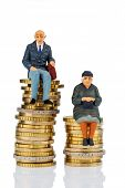 pensioners and pensioner sitting on money stack, symbol photo for retirement and inequality,