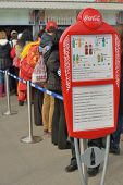 SOCHI, RUSSIA - FEBRUARY 12, 2014: Menu against people waiting in the line to cafe in Olympic Park.