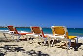 Chaise longues on caribbean sea beach