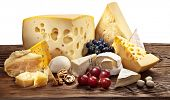 picture of brie cheese  - Different types of cheese over old wooden table - JPG