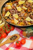 Paella with seafood on wooden table