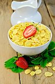 Cornflakes With Strawberries And Milk On Board