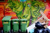 :Street art Montreal women and garbages