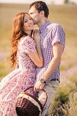 picture of windy weather  - Young beautiful sensual couple kissing outdoors in windy weather in the summer on a lavender field - JPG