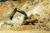 Yellow excavator, dredge