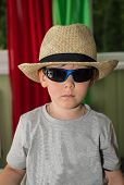 Boy In A Hat And Sunglasses.