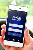 Hand Holding Mobile Phone With Banking Log In Page