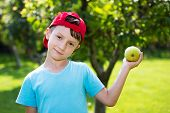 Little Boy In Cap With Fresh Apple