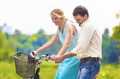 Happy Loving Caucasian Couple Having Fun Together Riding Bike Outdoors